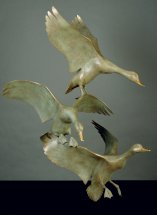 MALLARDS: Life size bronze sculpture
