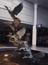 DECOLLAGE - MALLARDS TAKING OFF: Bronze public sculpture. Jersey airport